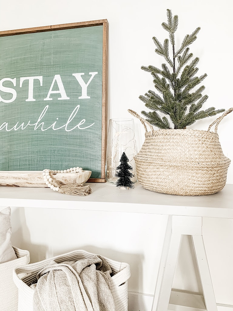 Tree in basket on console table