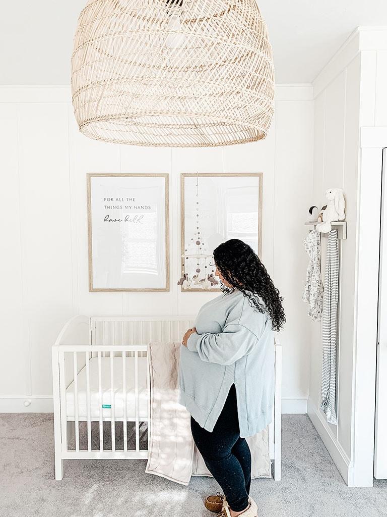37 Week pregnancy bump in neutral nursery