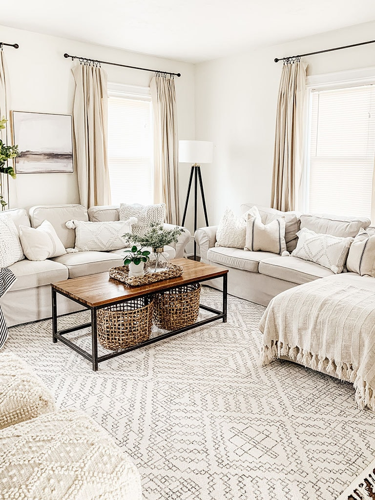 Sherwin Williams Alabaster painted walls. Rectangle coffee table with geometric area rug.